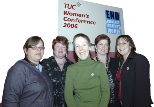 Five women standing together in front of a white banner which says 'TUC Women's Conference 2006' in red nd has a blue 'End violence against women' logo in the top right hand corner.